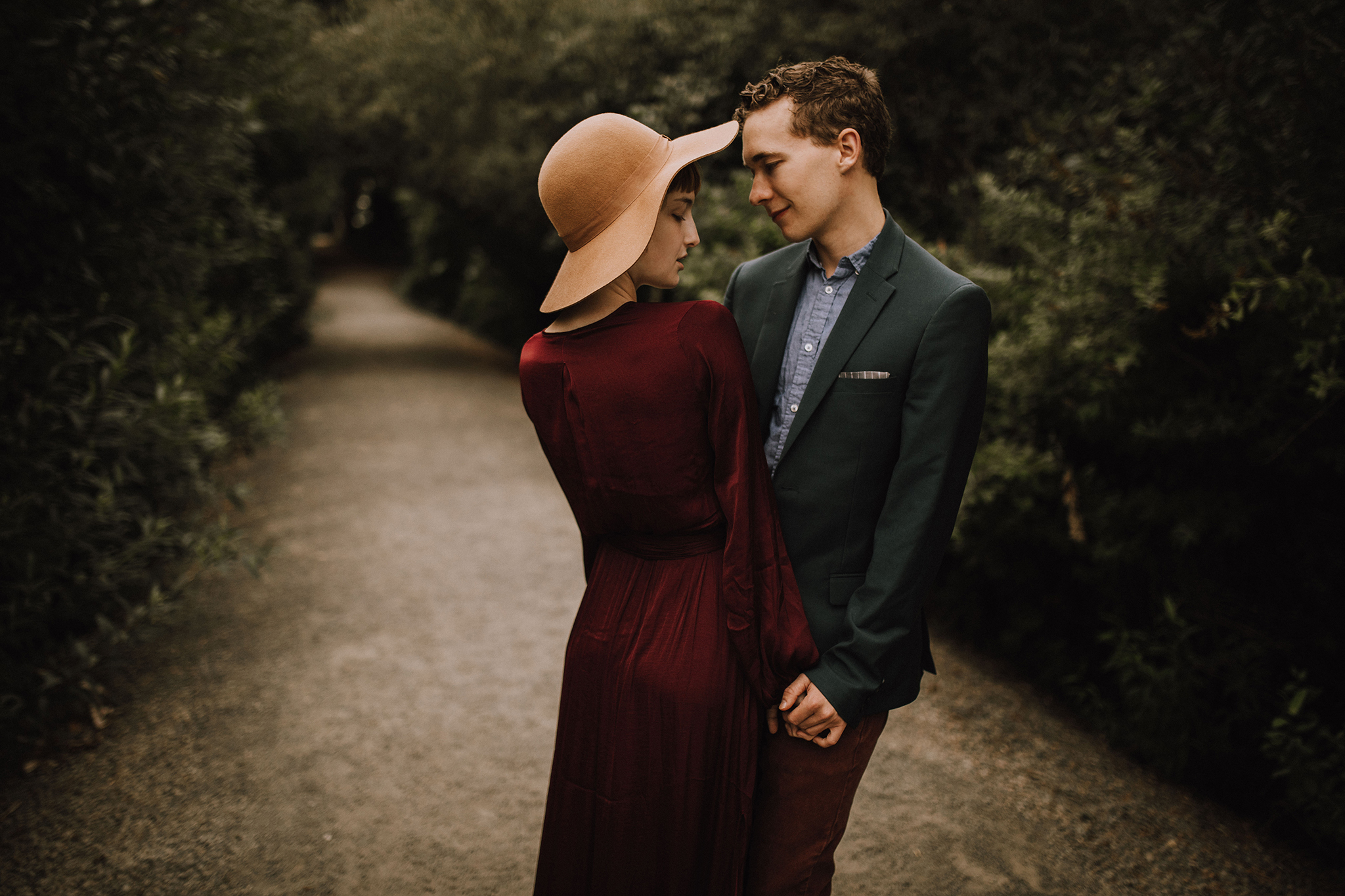 Myrtle and Moss Photography, Styled Couple Session on a boardwalk and dock, girl in red dress and hat